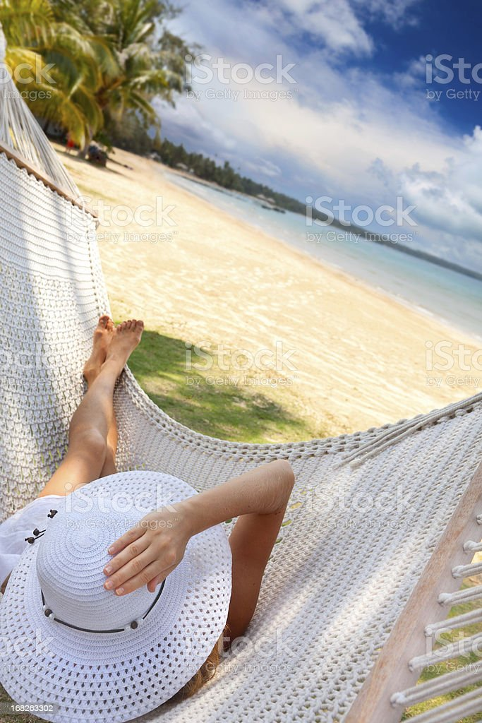 Young woman relaxing in a hammock. royalty-free stock photo