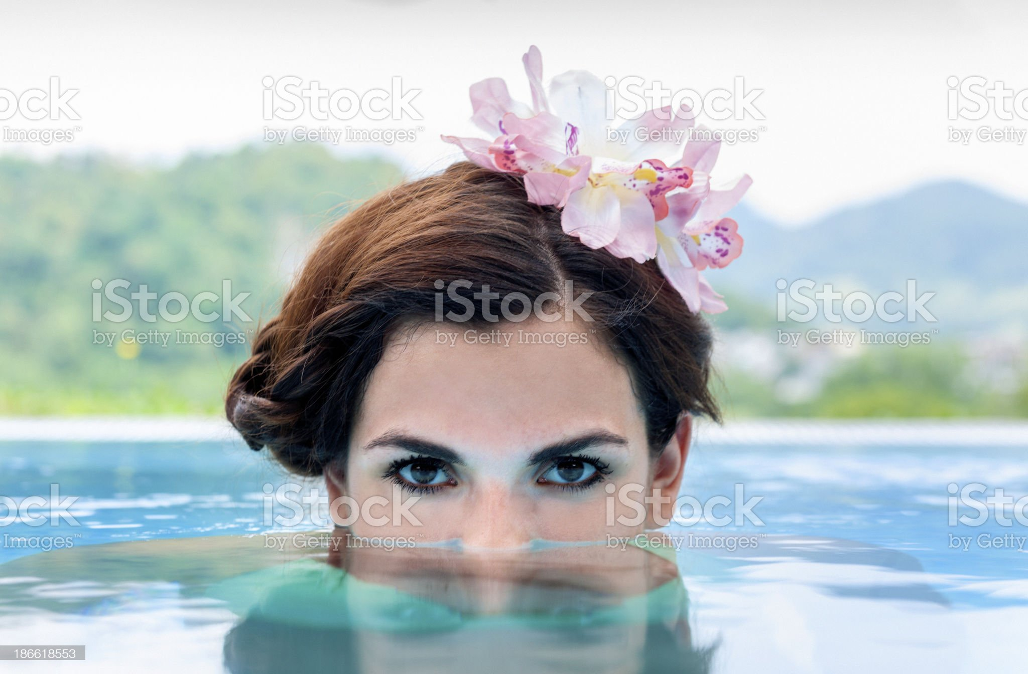 young woman relaxing in resort swimming pool royalty-free stock photo