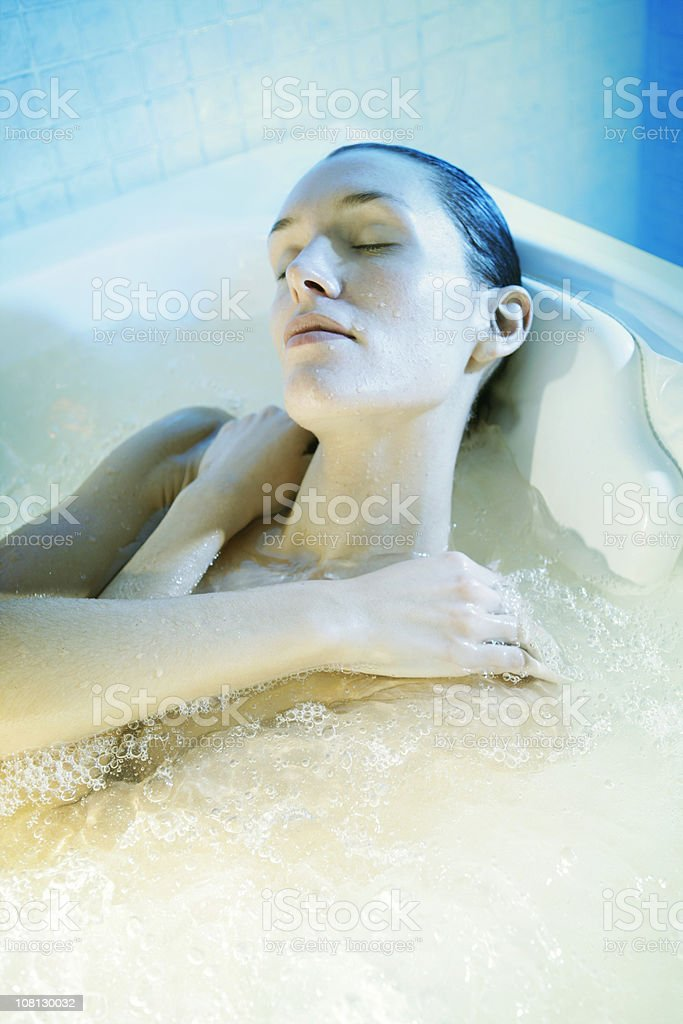 Young Woman Relaxing in Spa Bubble Bath royalty-free stock photo
