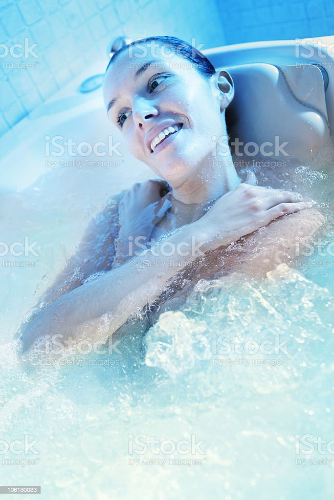 Young Woman Relaxing in Spa Soaker Tub royalty-free stock photo