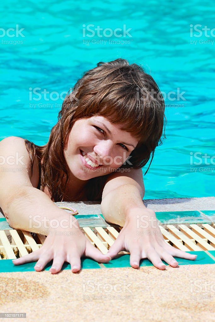 Young woman relaxing in swimming pool royalty-free stock photo