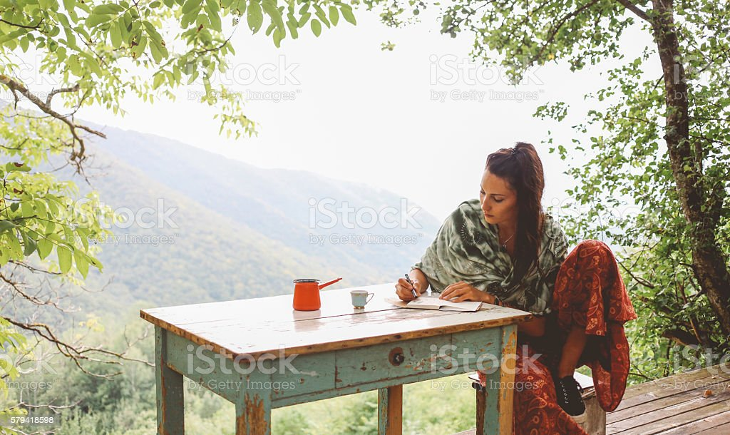 Young woman relaxing in the beautiful nature stock photo