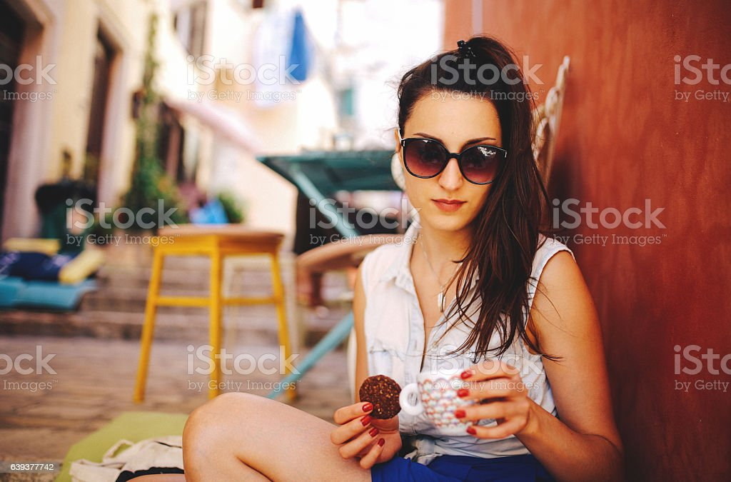 Young woman relaxing in the cafe stock photo