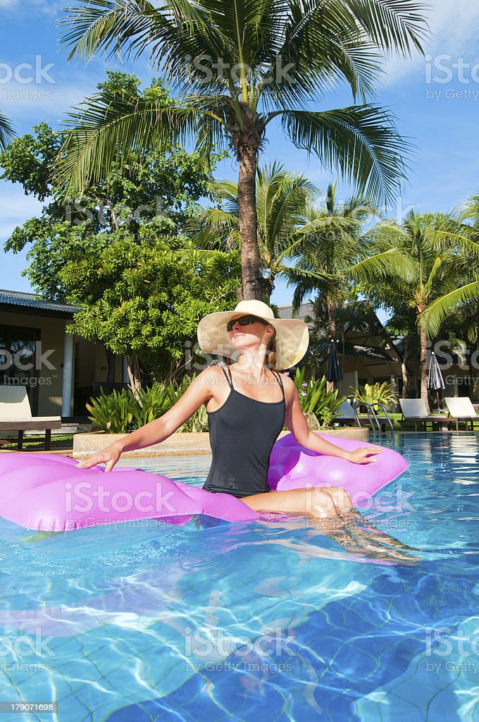 Young woman relaxing in the pool royalty-free stock photo