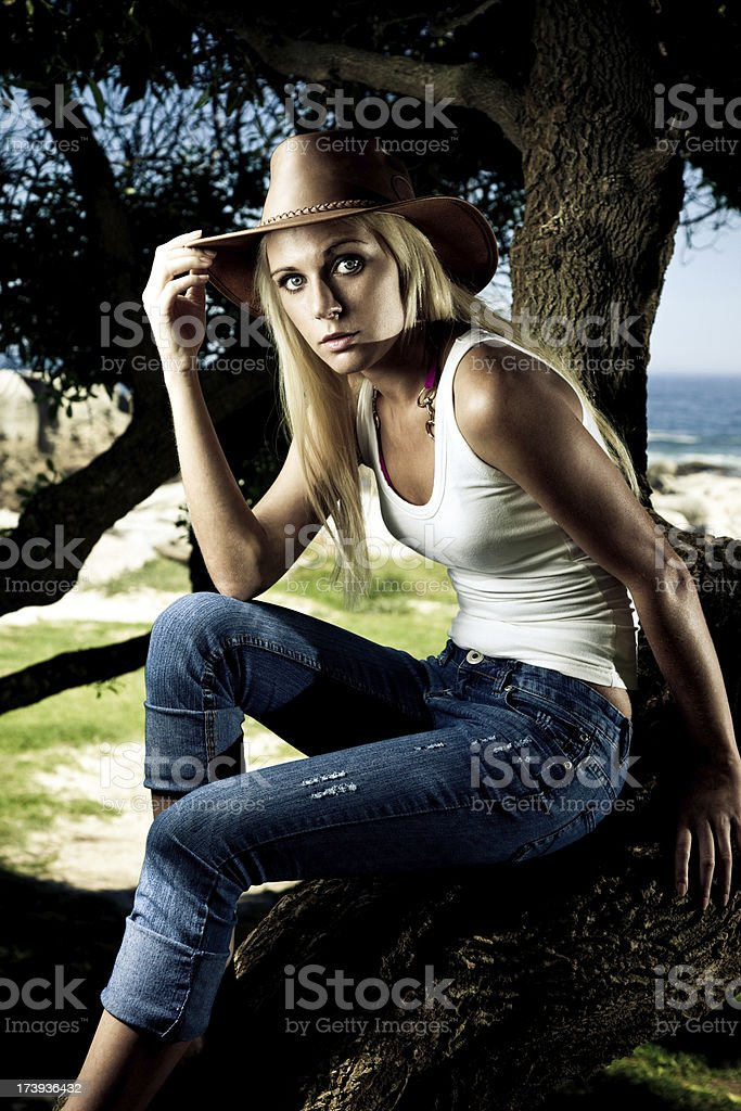 Young woman relaxing in the shade royalty-free stock photo