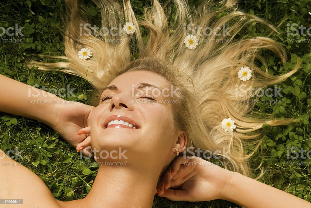 Young woman relaxing on a meadow royalty-free stock photo