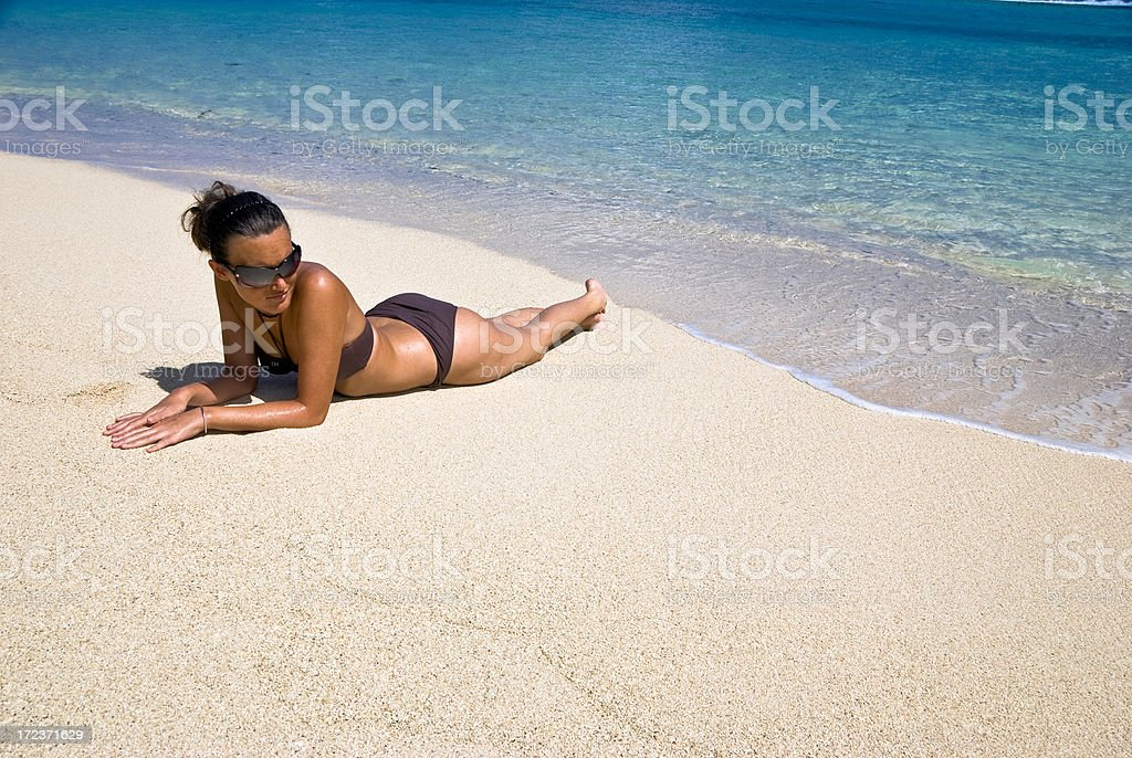 Young woman relaxing on a tropical beach royalty-free stock photo