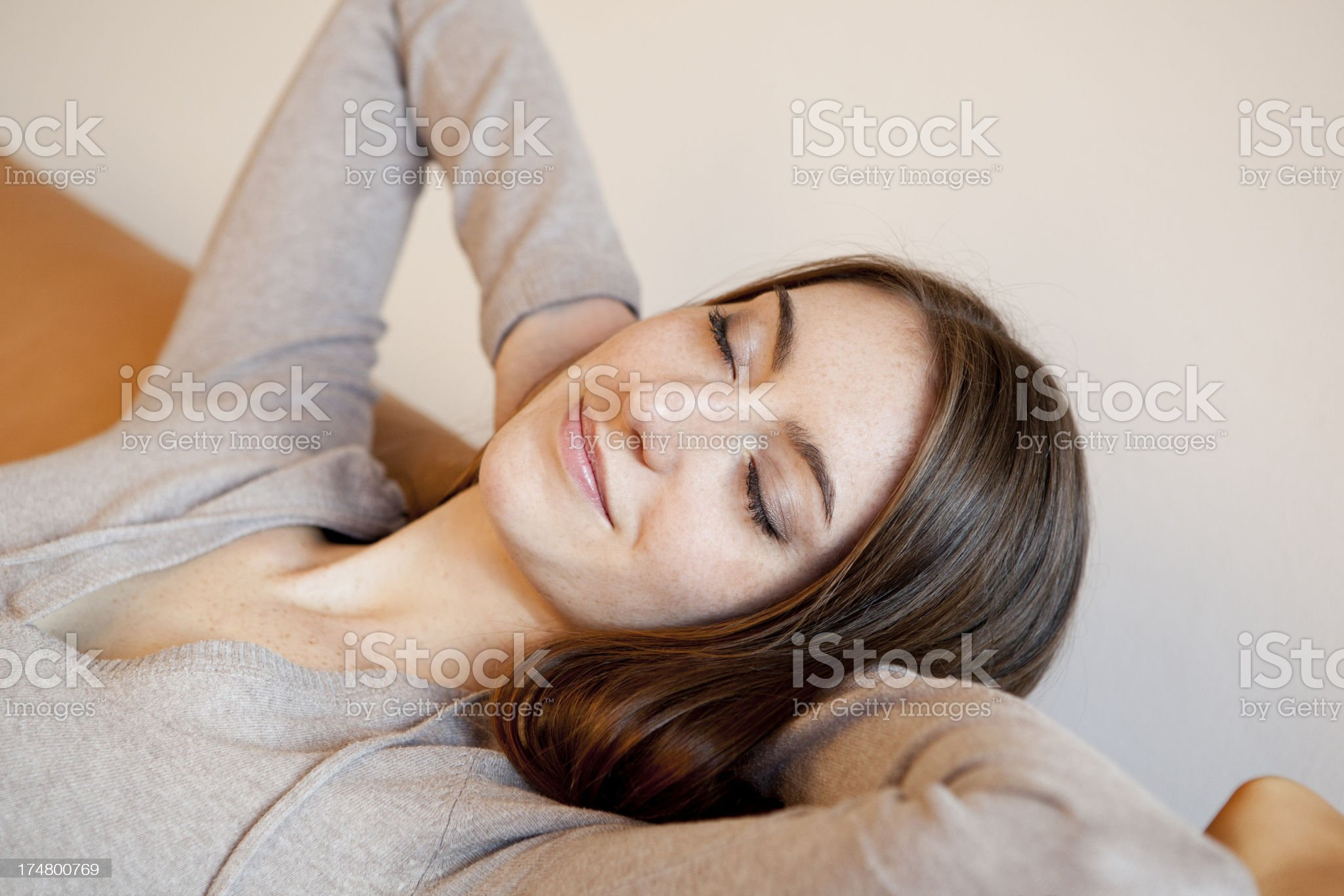 Young woman relaxing on sofa royalty-free stock photo
