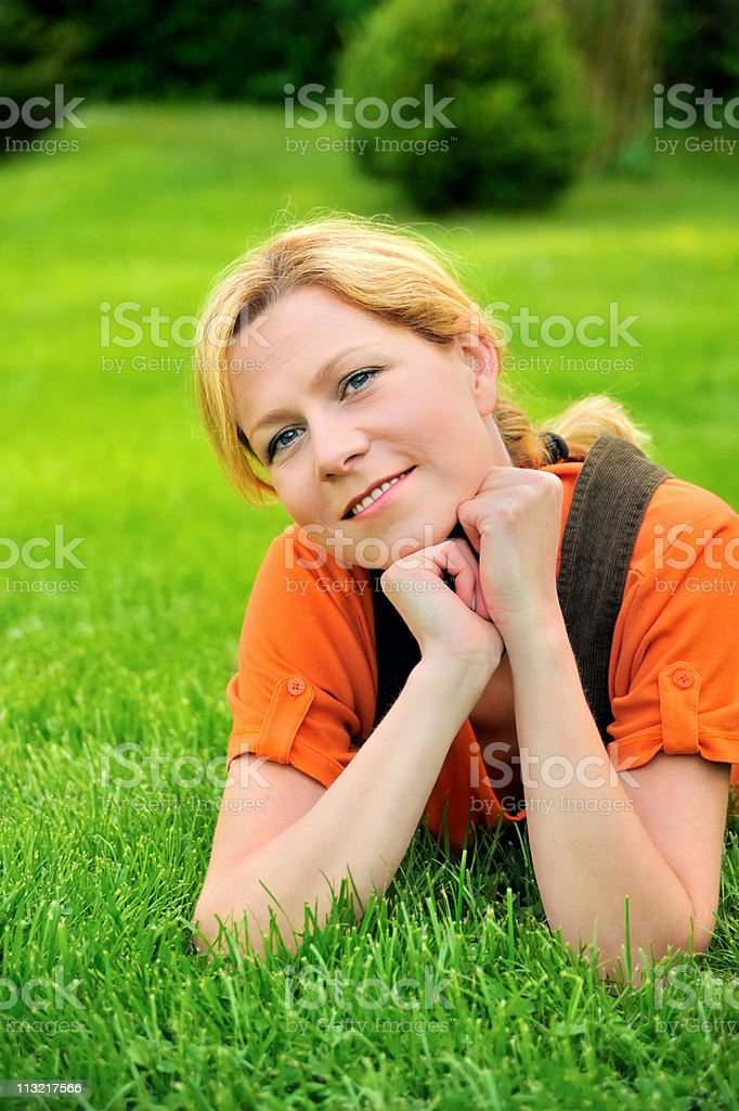 Young woman relaxing on the grass royalty-free stock photo