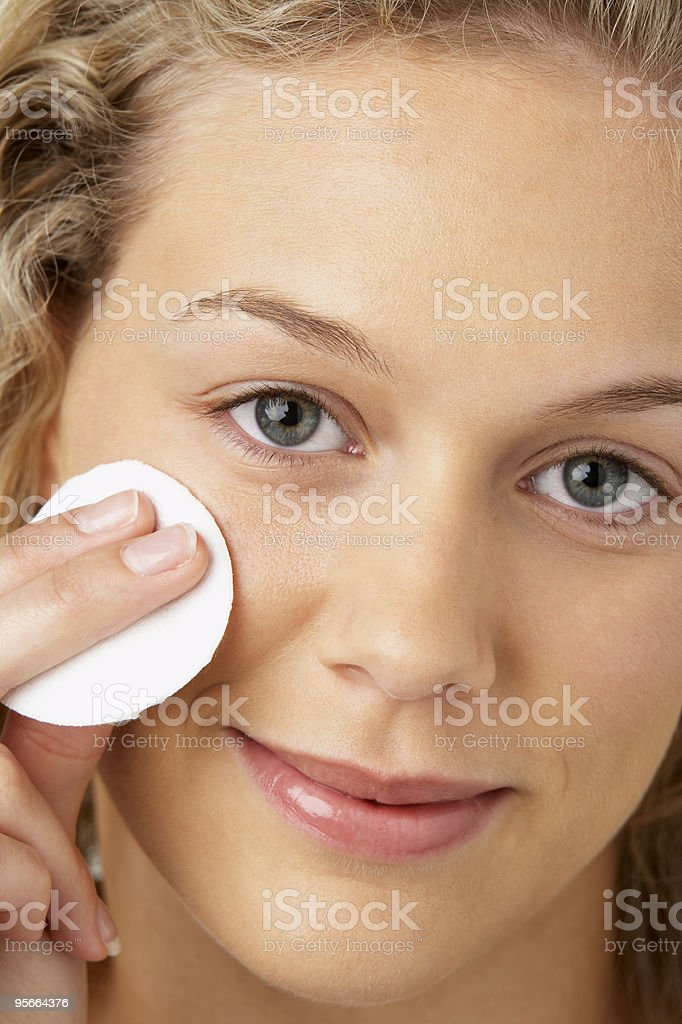 Young Woman Removing Make-Up royalty-free stock photo