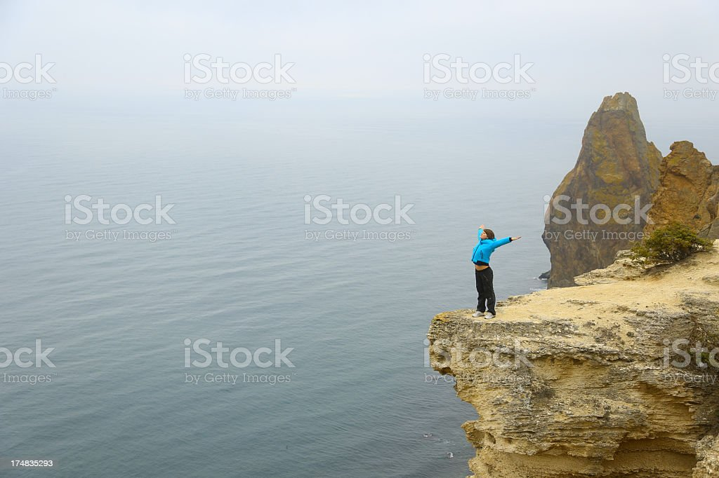 young woman rest on the mountain coast royalty-free stock photo