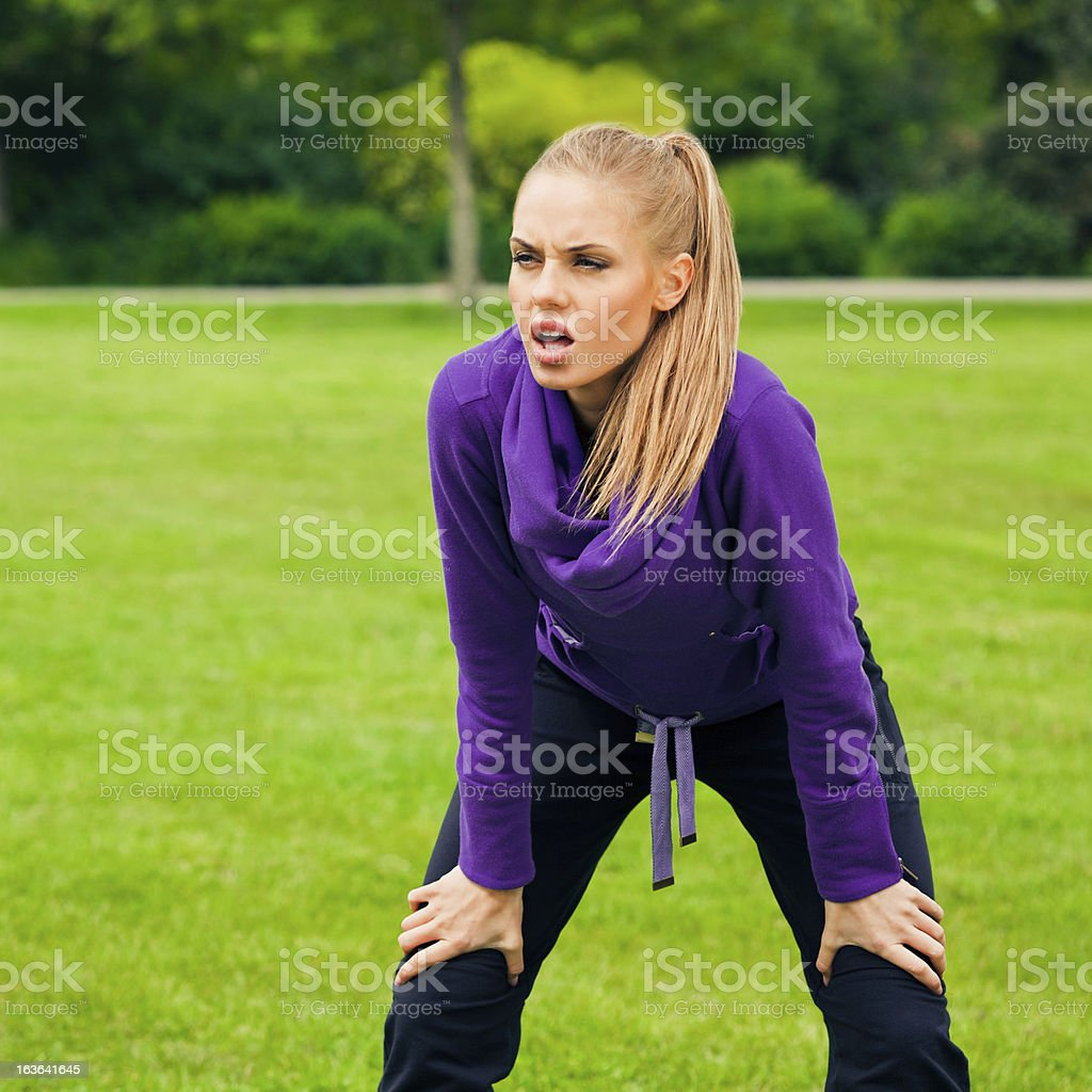 Young woman resting after jogging royalty-free stock photo