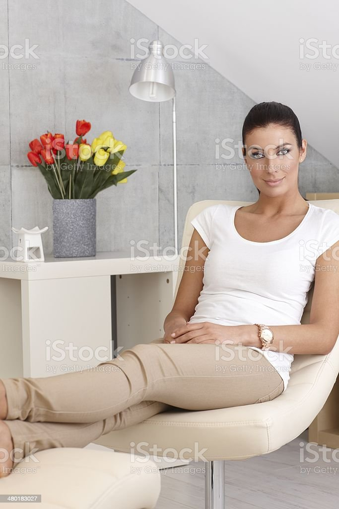 Young woman resting at home stock photo