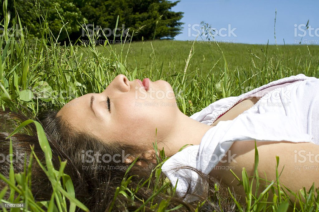 Young Woman Resting In The Grass royalty-free stock photo