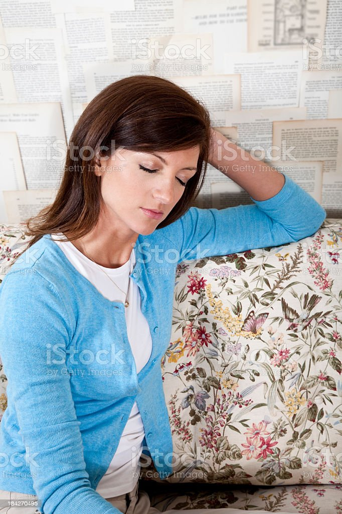 Young woman resting on couch stock photo