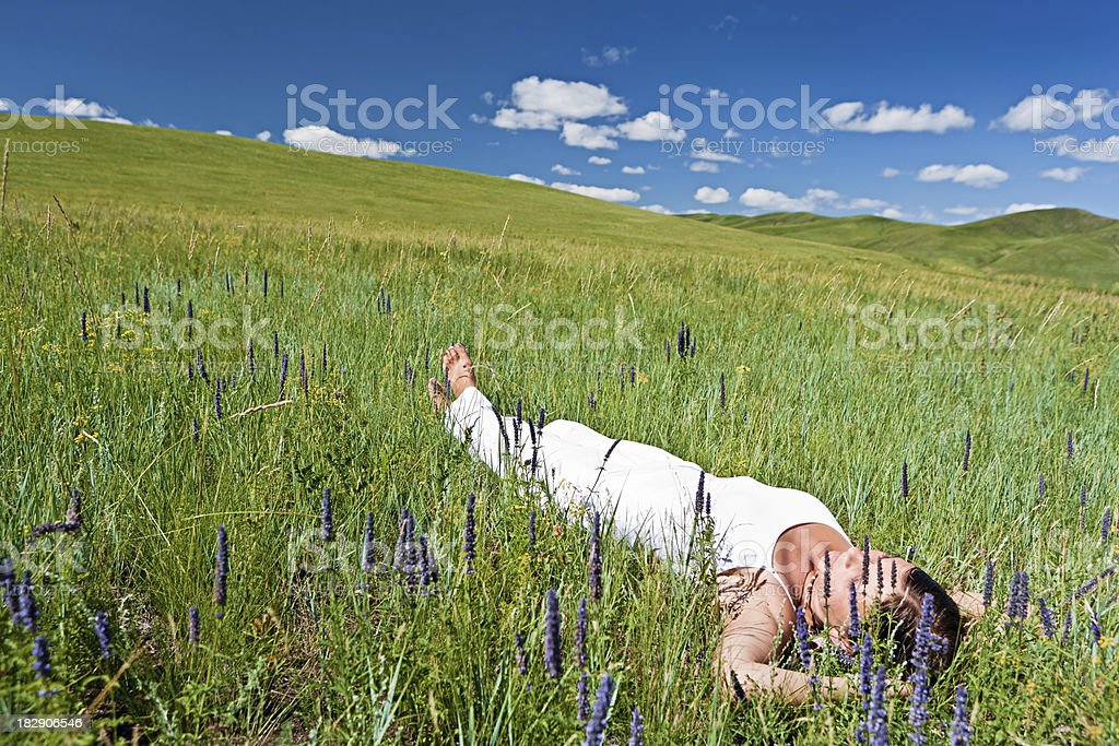 Young woman resting on the grass royalty-free stock photo