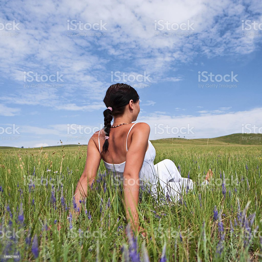 Young woman resting on the grass stock photo