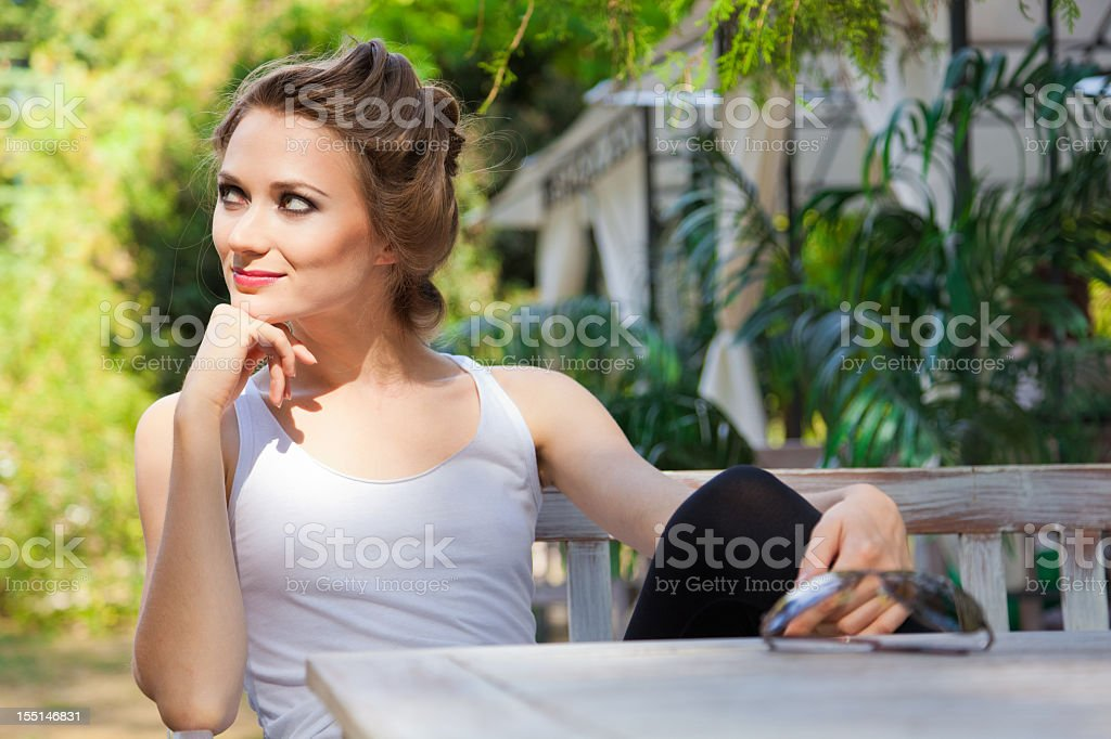 Young woman resting outdoors in picturesque oasis royalty-free stock photo