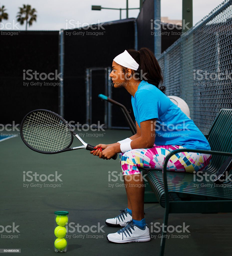 Young woman rests between tennis matches stock photo