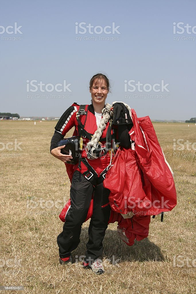 Young woman returns from skydive royalty-free stock photo