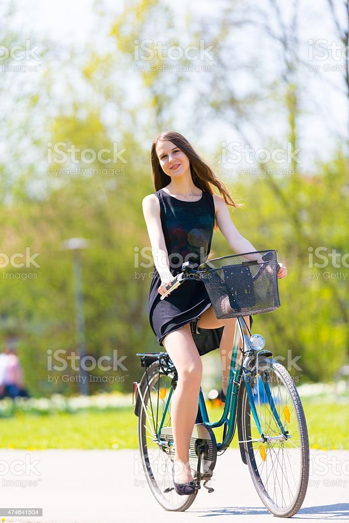 Young woman rides a bicycle stock photo