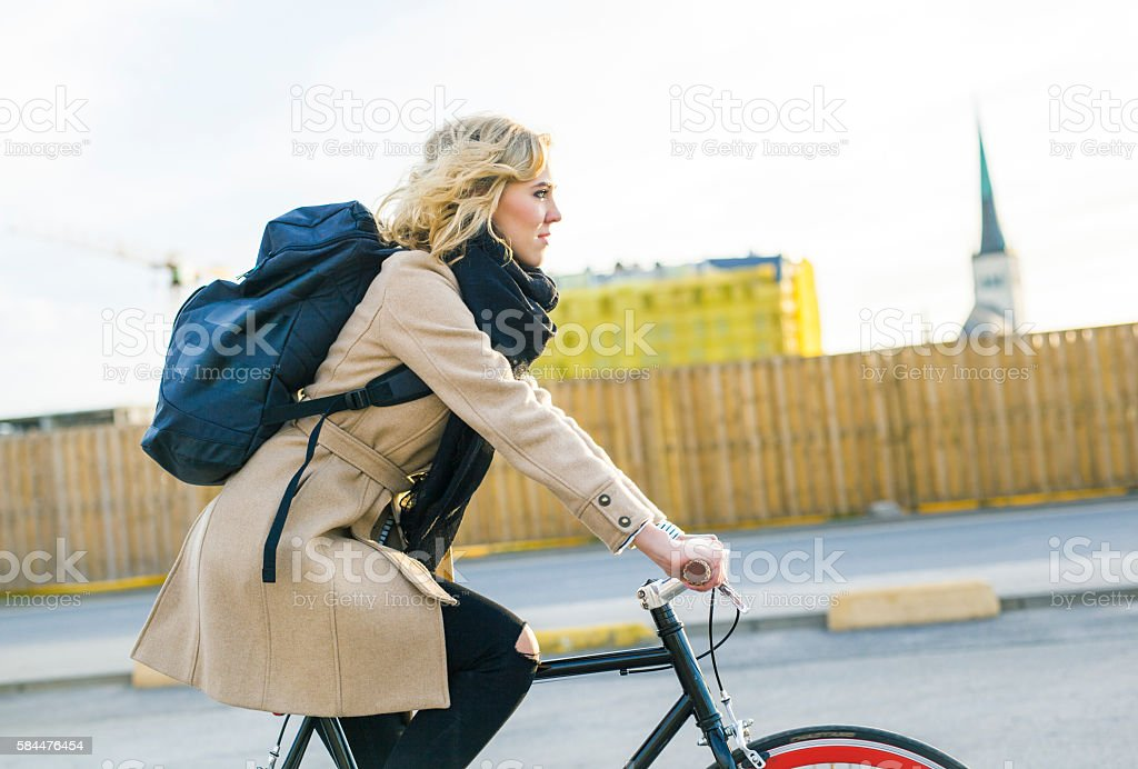 Young Woman Riding A Bicycle To Refresh The Mind stock photo