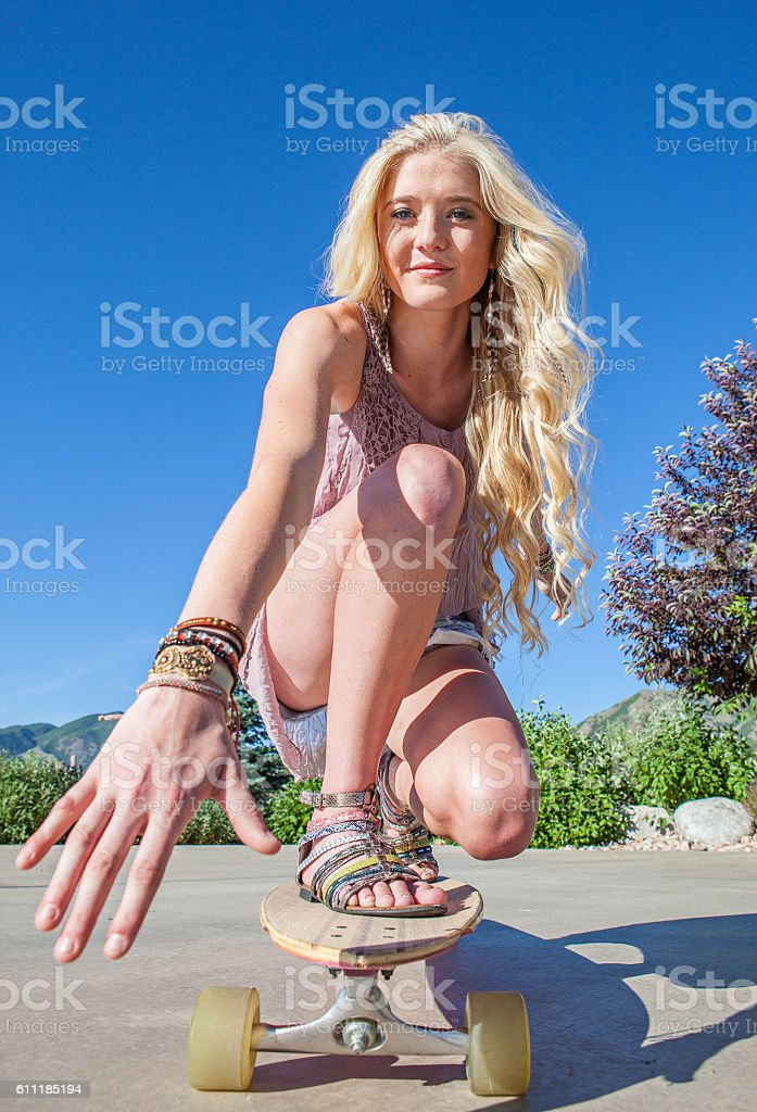 Young Woman Riding a Longboard stock photo
