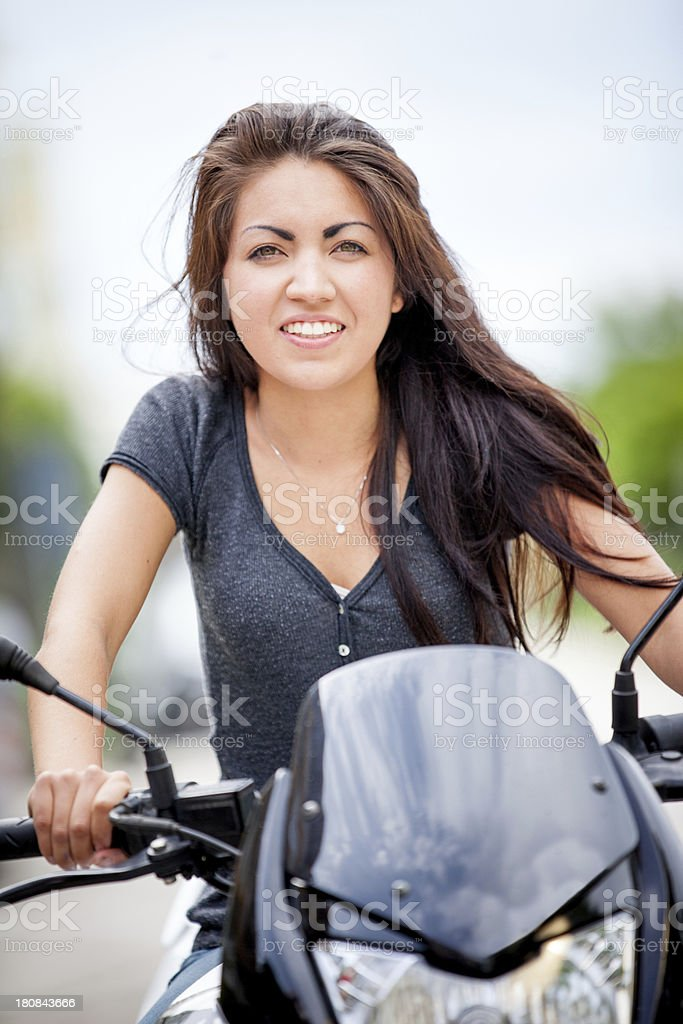 Young woman riding a motorcycle royalty-free stock photo