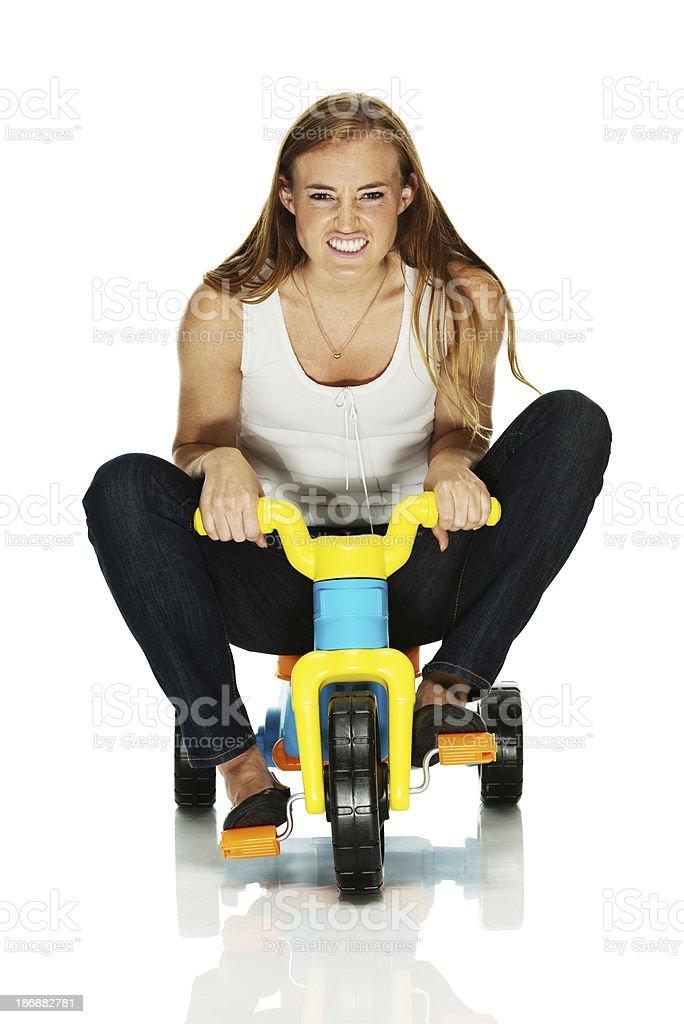 Young woman riding a tricycle royalty-free stock photo