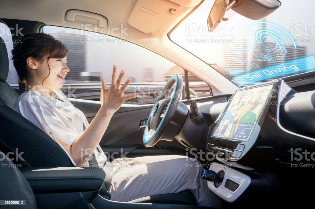 young woman riding autonomous car. self driving vehicle. autopilot. automotive technology. stock photo