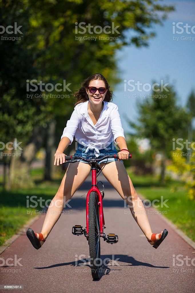 Young woman riding bike stock photo