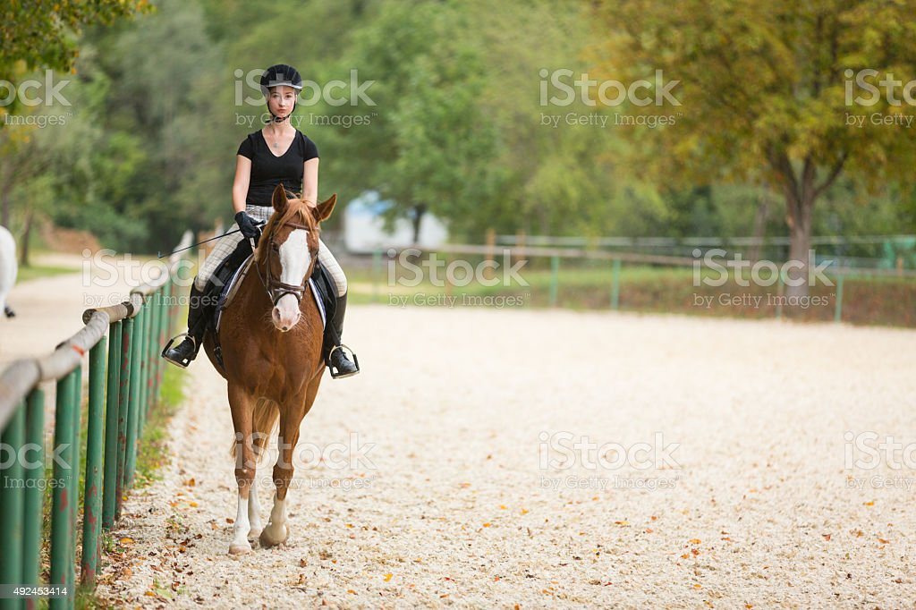 Young Woman Riding Her Horse stock photo