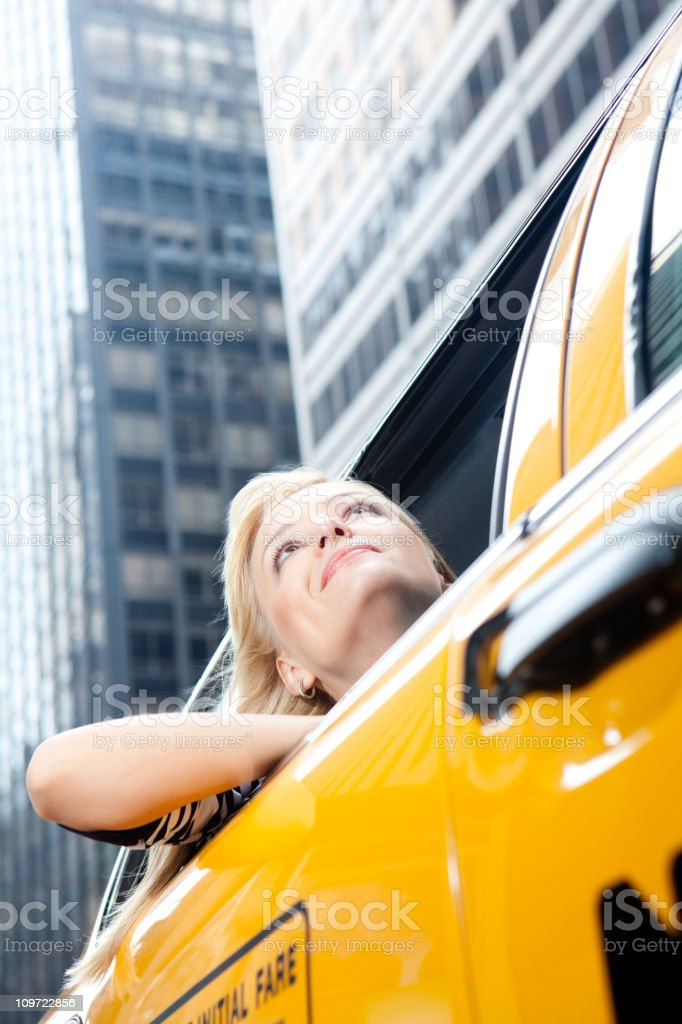 Young woman riding in nyc yellow taxi stock photo