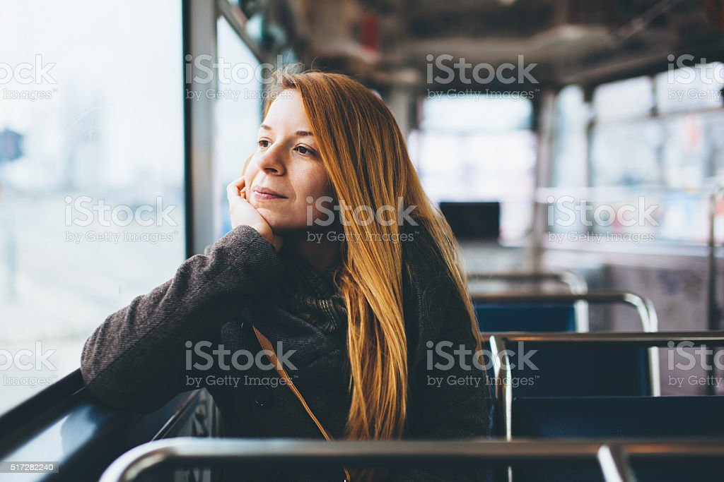 Young woman riding in public transport stock photo