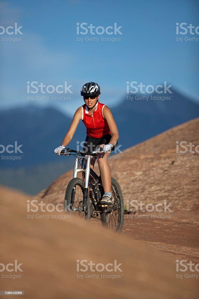 Young Woman Riding Mountain Bike In Utah Park royalty-free stock photo