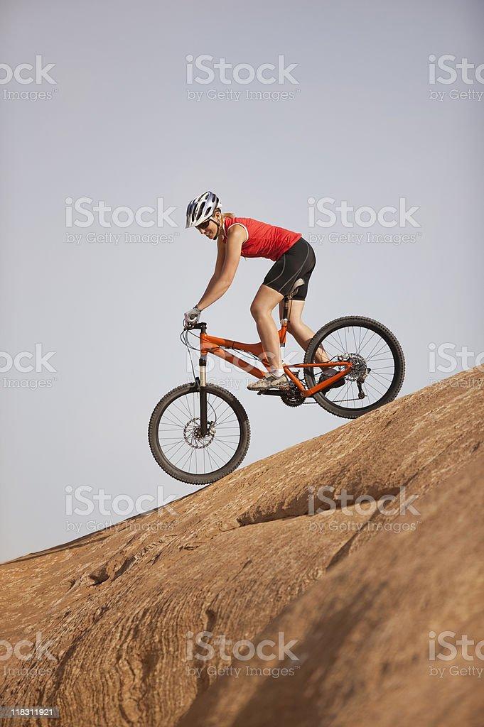 Young Woman Riding Mountain Bike On Slickrock Trail Moab, Utah royalty-free stock photo