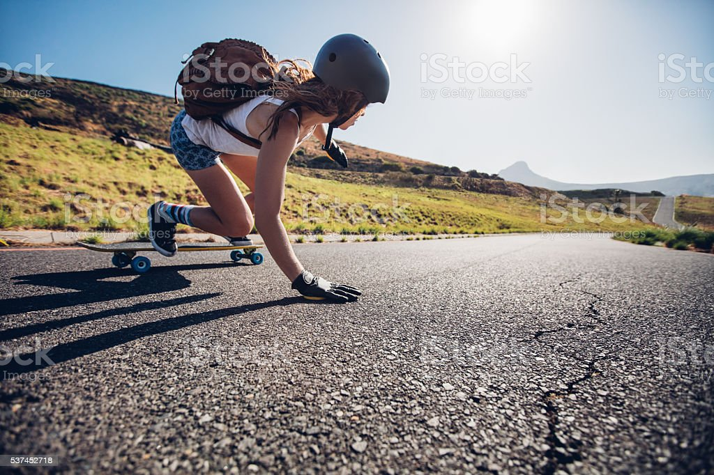 Young woman riding on her skateboard stock photo