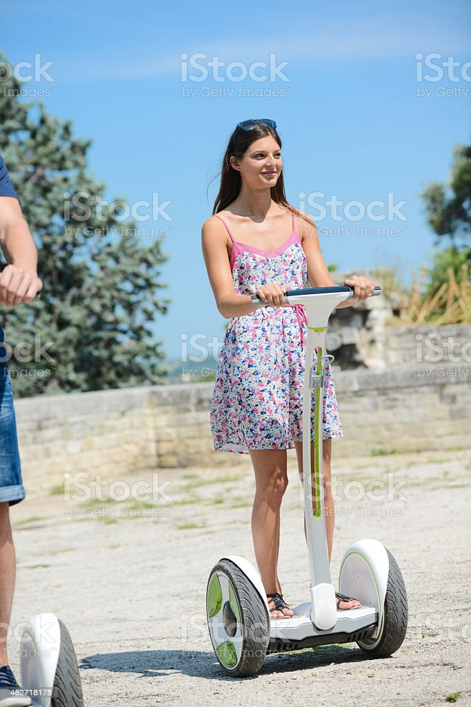 young woman riding segway gyropode electric vehicle on sightseeing tour stock photo