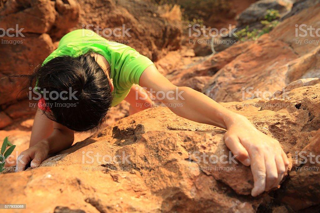 young woman rock climber climbing at  mountain rock stock photo