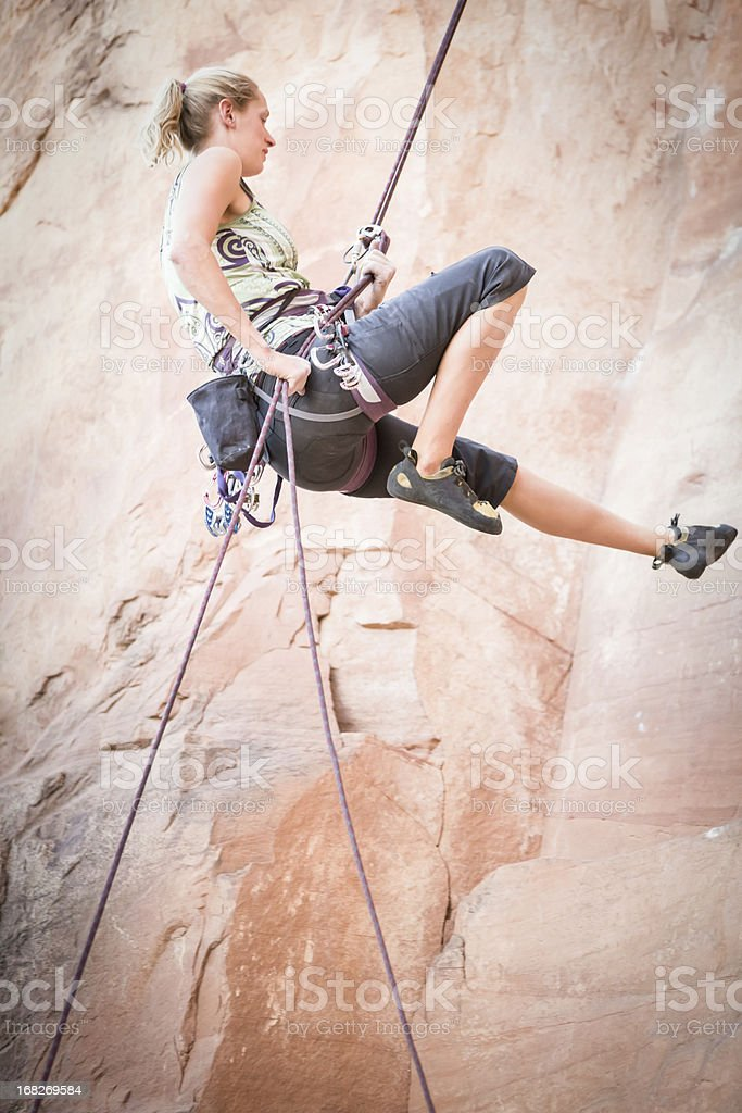 Young Woman Rock Climber on a sandstone cliff stock photo