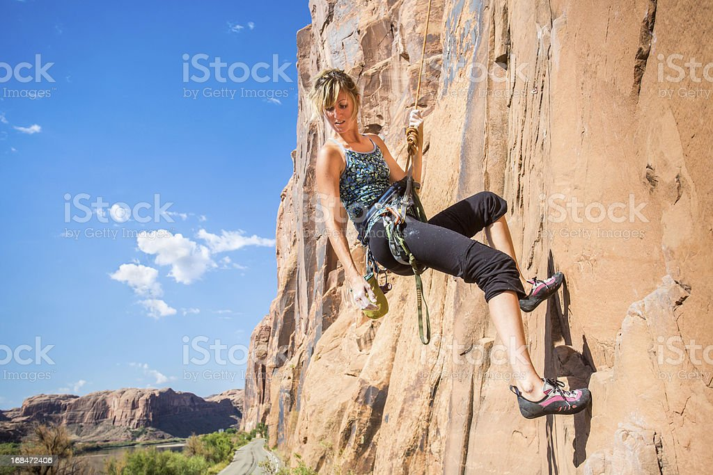 Young Woman Rock Climber on a sandstone cliff royalty-free stock photo