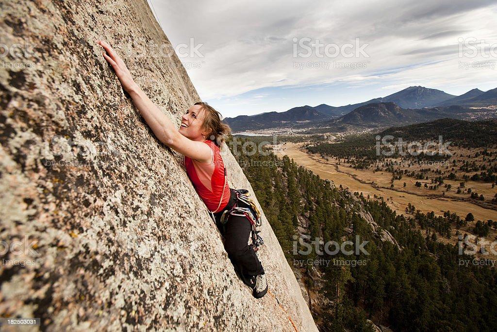 Young Woman Rock Climbing royalty-free stock photo