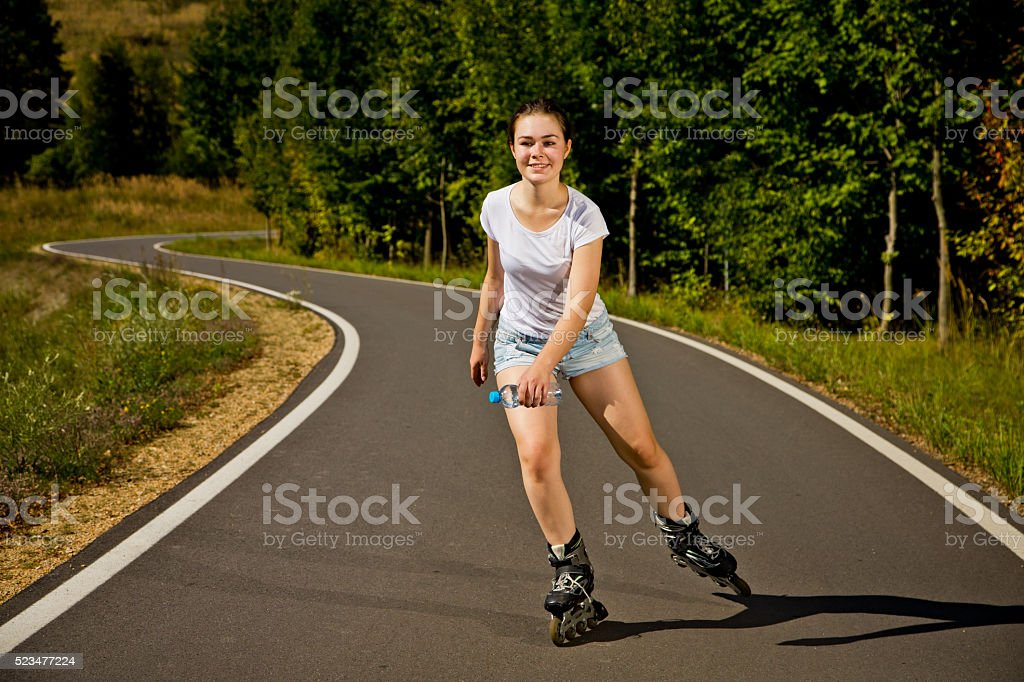 Young woman rollerblading outdoor stock photo
