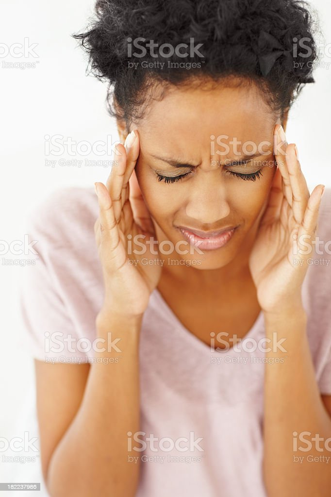 A young woman rubbing her temples due to a headache royalty-free stock photo