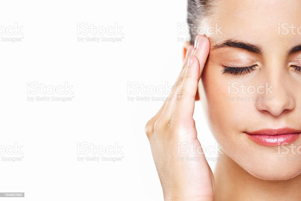 Young Woman Rubbing Her Temples stock photo