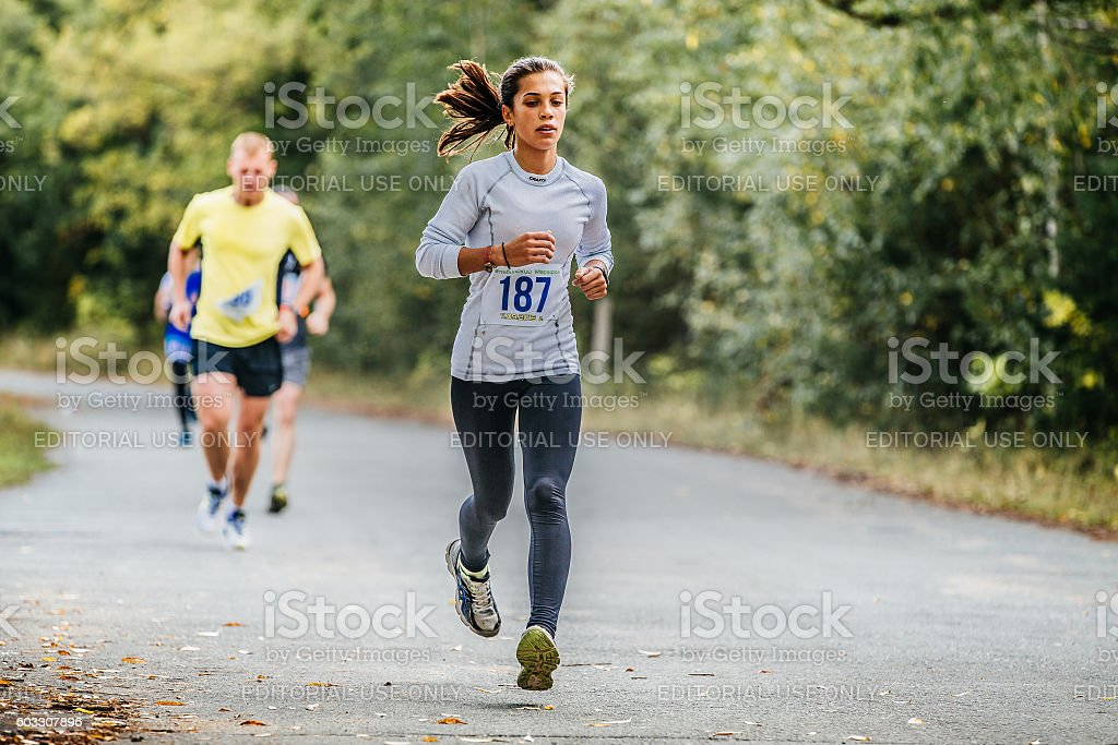 young woman runner running in autumn Park royalty-free 스톡 사진