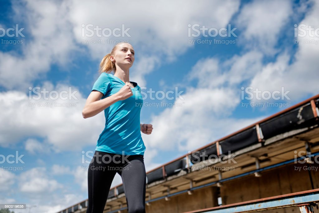 Young Woman Running in an Urban Environment. stock photo