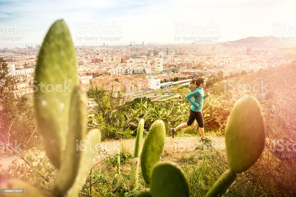 Young woman Running in Barcelona stock photo