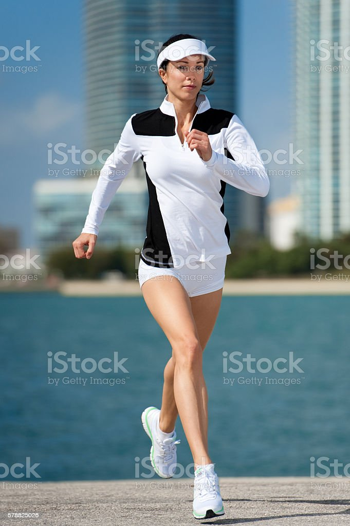 Young Woman Running Jogging by Bay stock photo