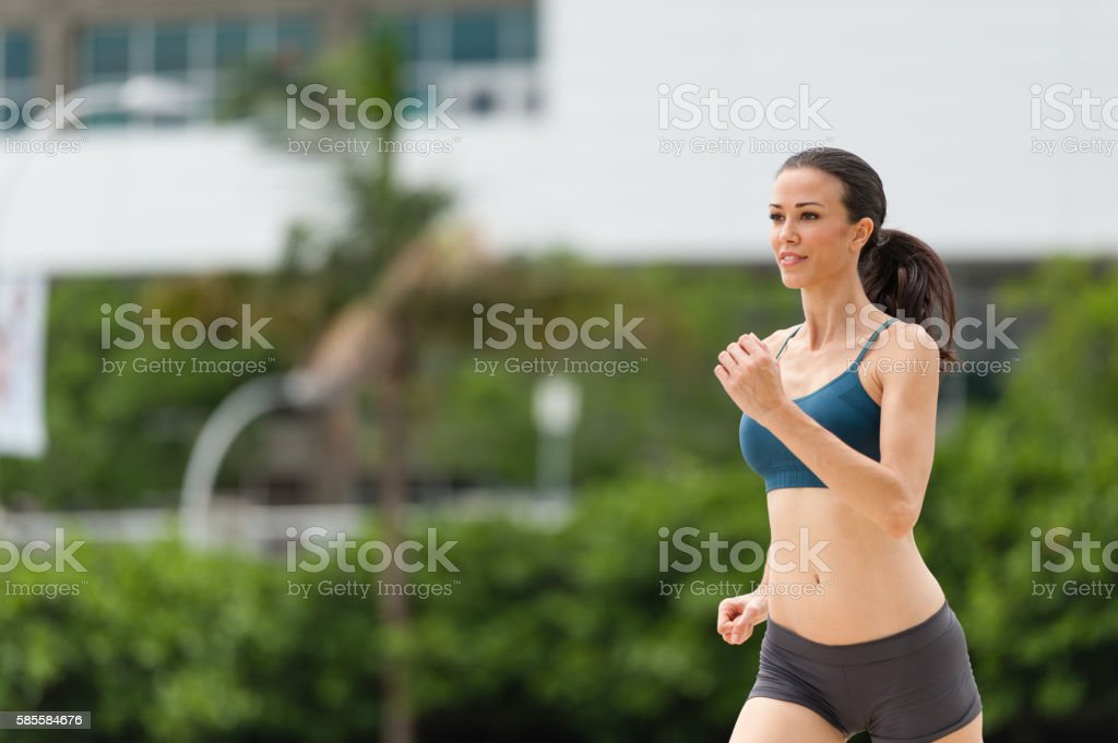 Young Woman Running Jogging stock photo